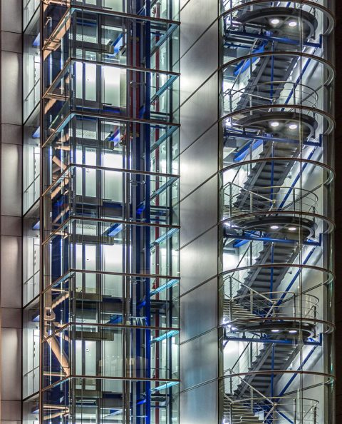 lift shaft and staircase in lights on side of modern office building