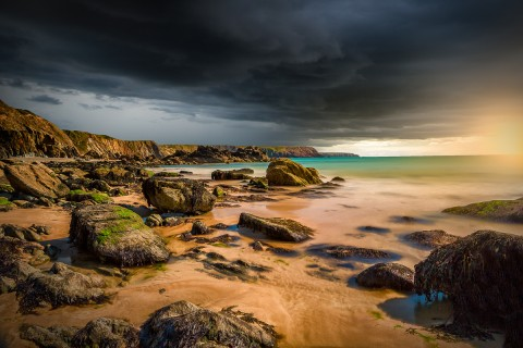 Storm clouds and sunset at Anglesey beach in Wales