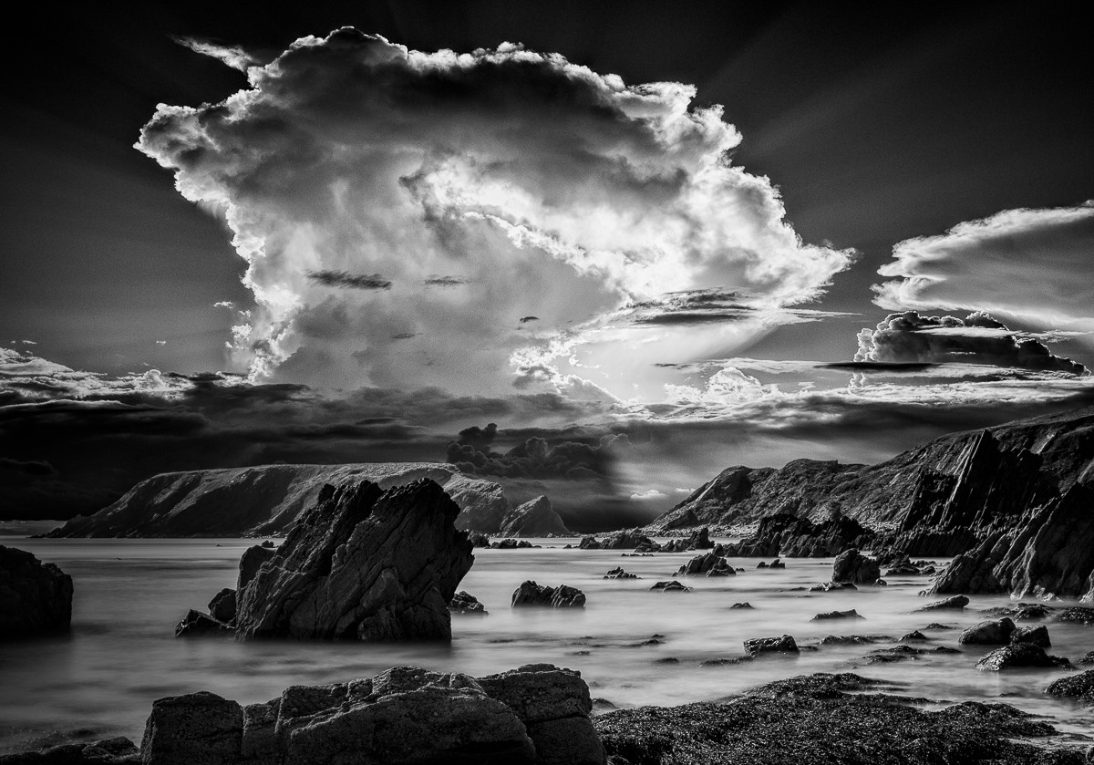 Anglesey Beach and Rocks in Black and White with powerful storm clouds