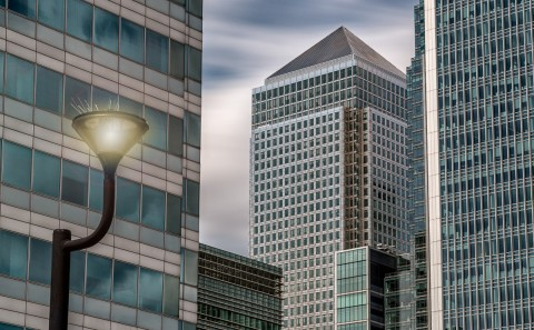 Canary Wharf Tower and offices with street lamp in London