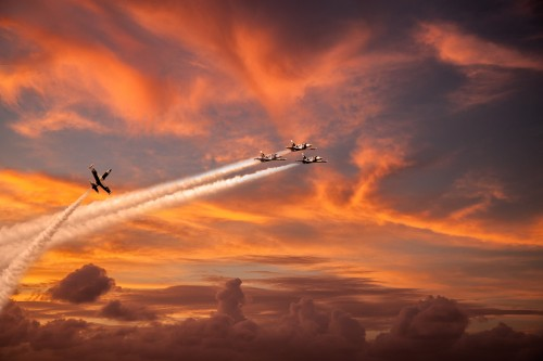Fighter jet airplanes on sunset red sky