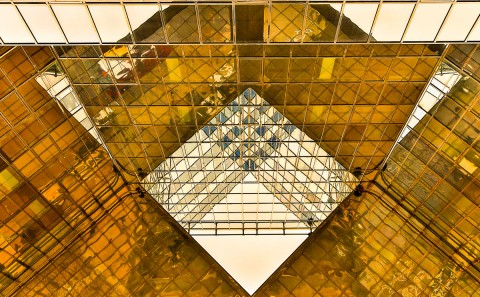 golden triangle glass mirrored office building architecture
