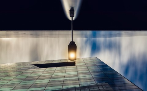 lit street lamp between modern office glass buildings long exposure architecture