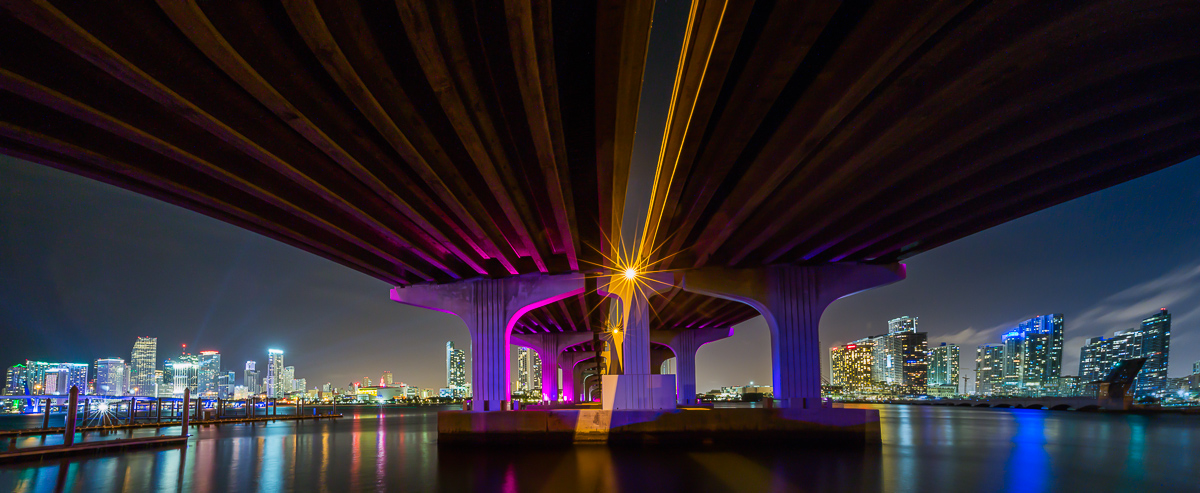 architecture macarthur causeway floyover in miami at night with skyline panorama