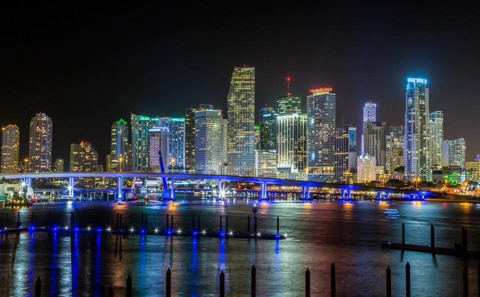 Miami Skyline at Night in lights with Biscayne Bay Florida architecture