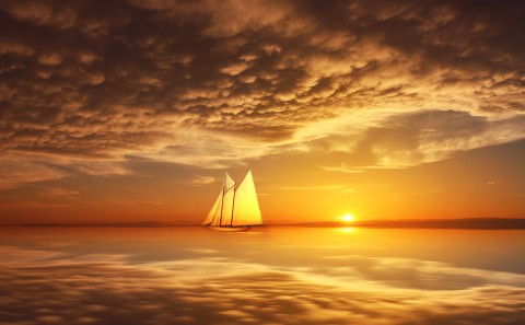 Sailboat at Sunset reflections on the Ocean