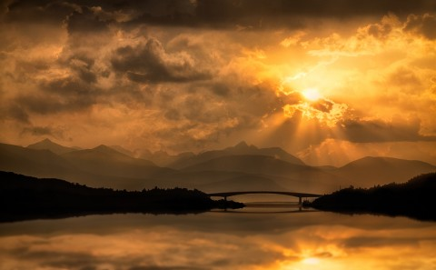 Sunset over Scottish Loch with bridge