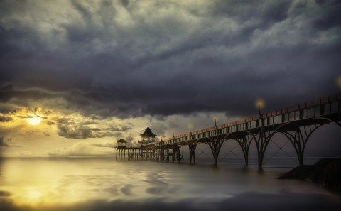 vintage pier jetty in Englad at sunset