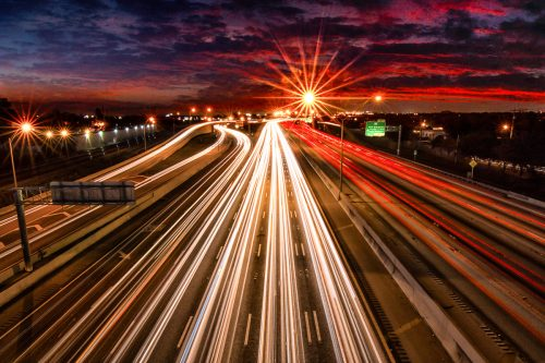 Sunset-freeway-highway-I95-car-light-trails