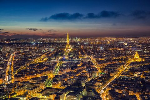 Paris city and Eiffel Tower at sunset night lights view from Montparnasse