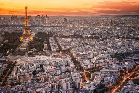 Paris city and Eiffel Tower at sunset ights view from Montparnasse