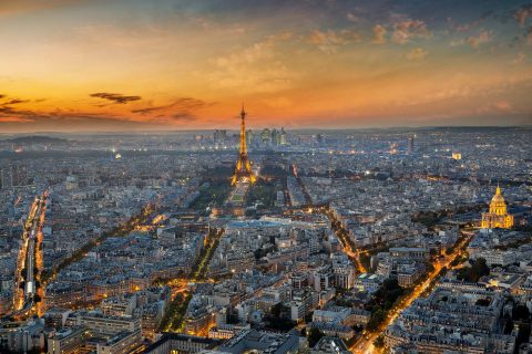 Paris city and Eiffel Tower at sunset lights view from Montparnasse