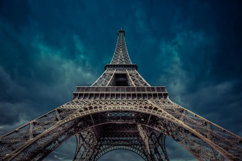 Eiffel Tower with cloudy sky and muted tones