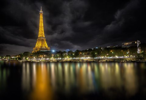 Eiffel Tower at Night in Paris with River Seine and Lights