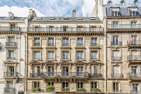 Paris architecture with balcony and window shutters street scenes