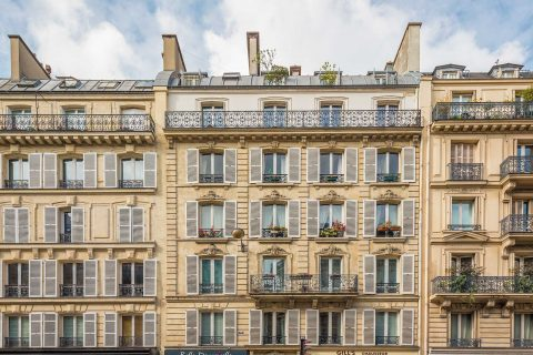 Paris architecture with balcony and window shutters