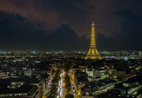 paris rooftops and Eiffel Tower and boulevards at night