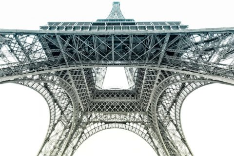 view of Eiffel Tower from below in muted color tones
