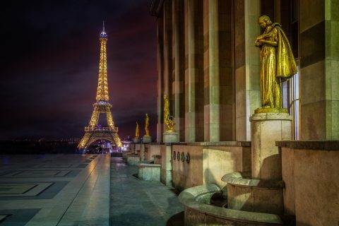 Eiffel Tower at Night in Paris with statues and Lights from Place de Concorde