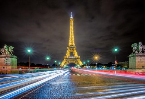 Eiffel Tower at Night in Paris with street and car trails and Lights