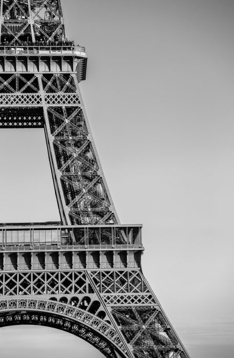 abstract section of Eiffel Tower in black and white in Paris France