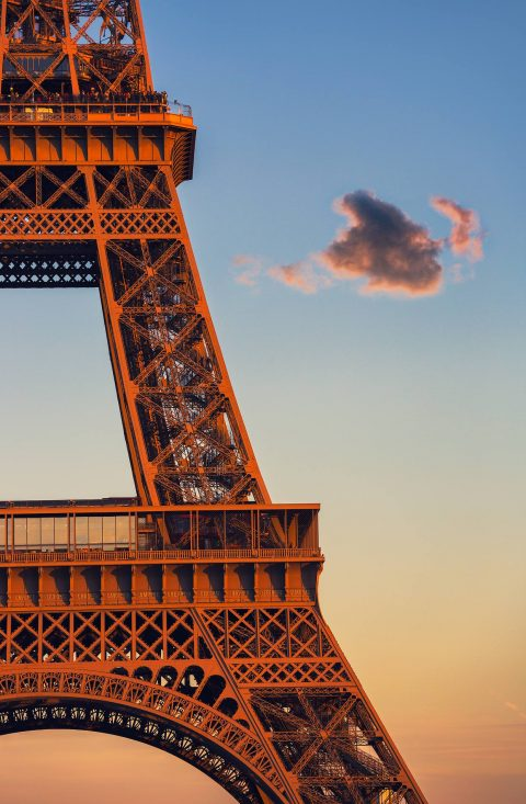 abstract section of Eiffel Tower in sunlight in Paris France