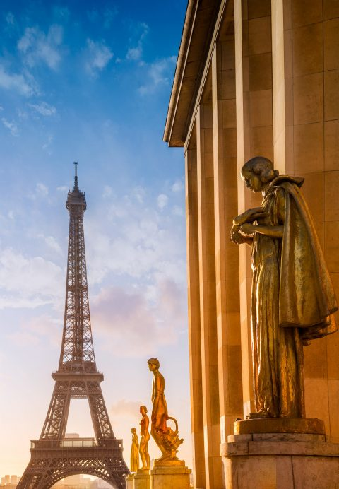 Eiffel Tower and statues in sunlight viewed from Place de Concorde