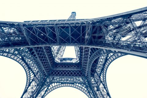 Abstract view of Eiffel Tower metalwork from below in muted color tones