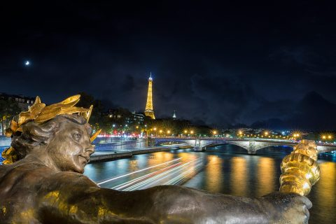 Eiffel Tower and River Seine and statues from Pont Alexandre III