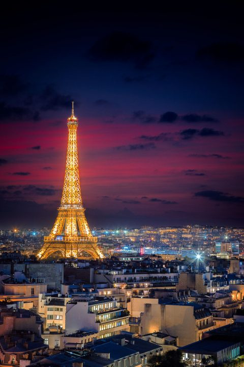 Eiffel Tower at night in lights with red sky sunset in Paris France