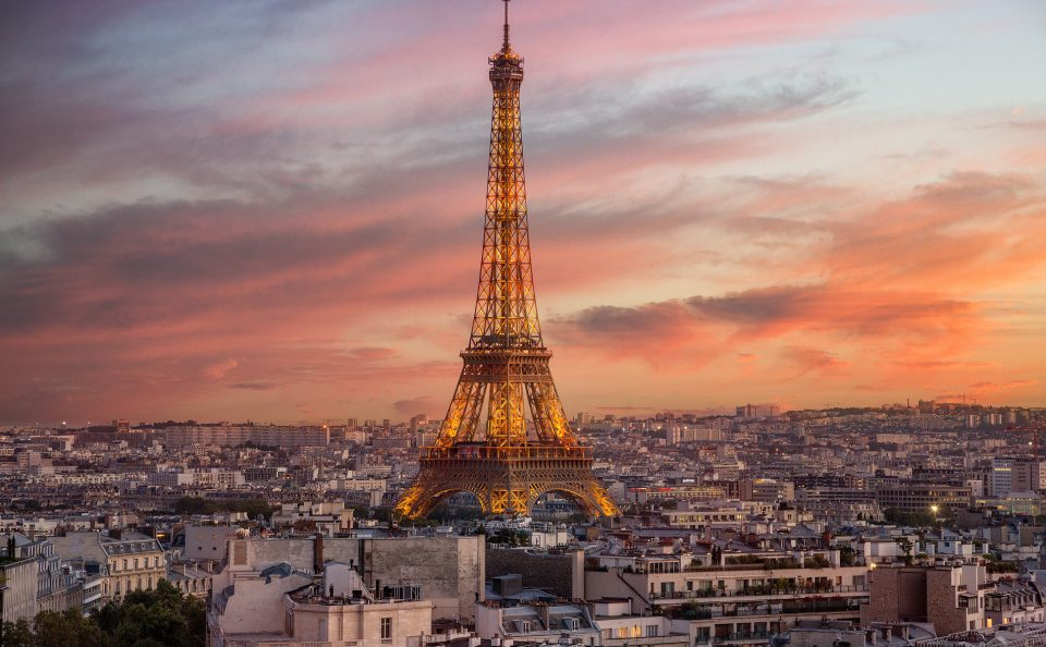 Eiffel Tower and Paris rooftops at sunset