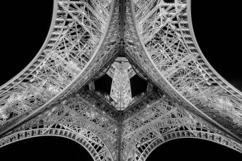 Abstract view of Eiffel Tower metalwork from below in black and white