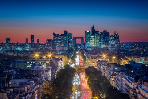 Paris La Defence Financial district at night with boulevard and sunset lights