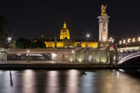 Paris Les Invalides and River Seine at Night with lights