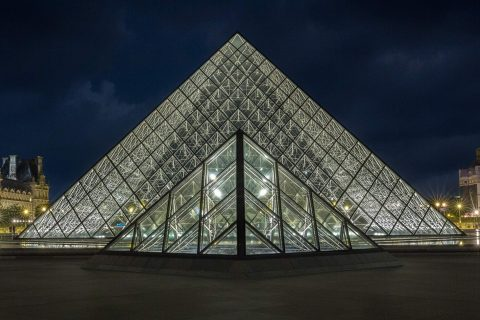 Louvre Museum glass pyramids at night in Paris France