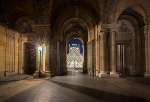 Entrance to the Louvre Museum at night in Paris France