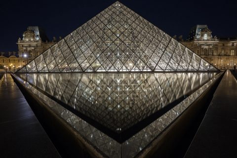 Louvre Museum at night in Paris France corner reflections