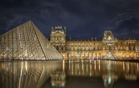 Louvre Museum at night in Paris France architecture