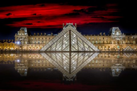 Louvre Museum at red sky night in Paris France