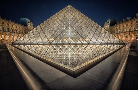 Louvre Museum at night in Paris France