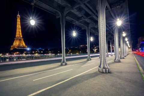 Paris Pont Bir Hakeim Bridge at night with car trails and eiffel tower