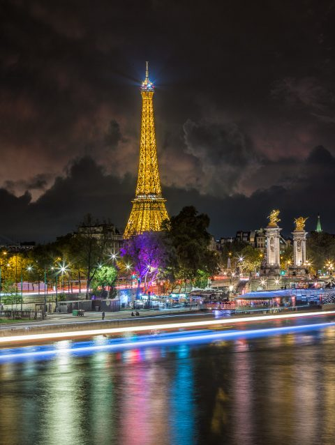 Paris view along river Seine with Eiffel Tower at Night in Lights