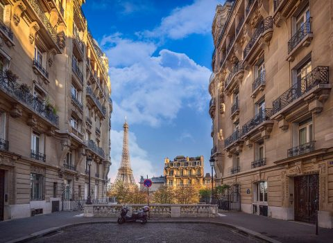 paris street with eiffel tower and local acthitecture