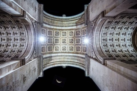arc de triumph triomphe viewed from below looking up at night