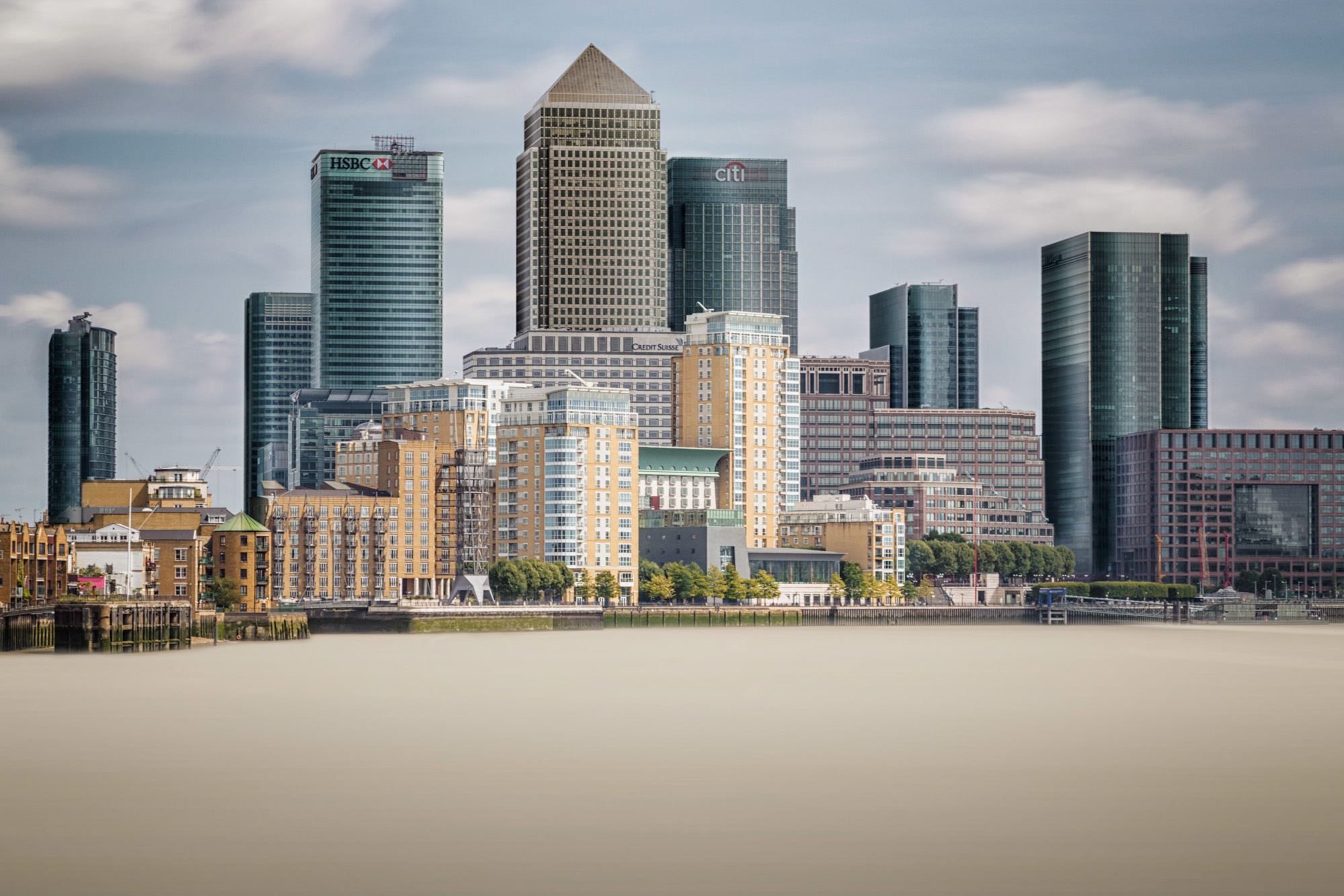 long exposure architecture photograph of Canary Wharf in London and River Thames