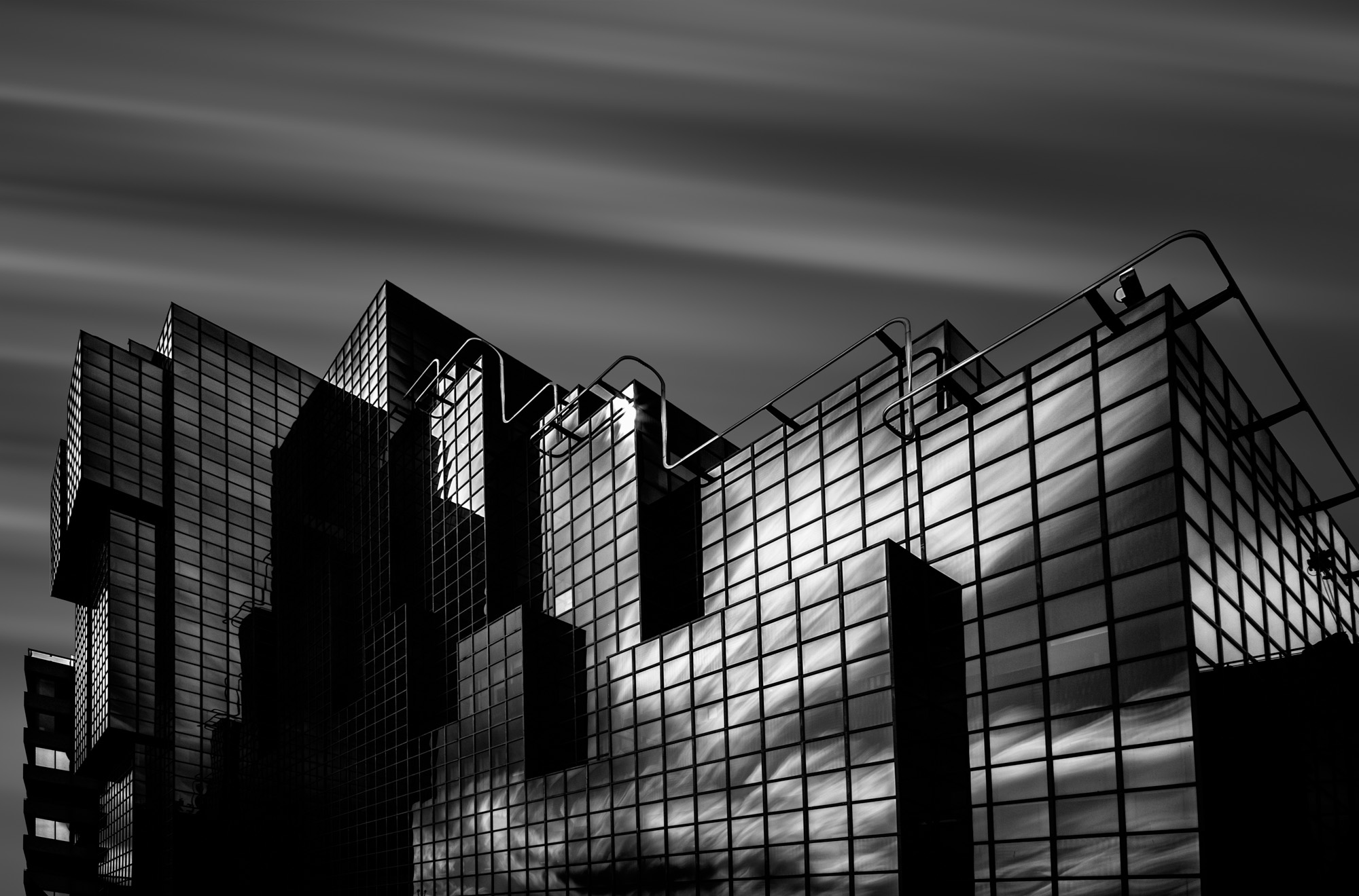 long exposure architecture photograph of modern glass mirrored building in London