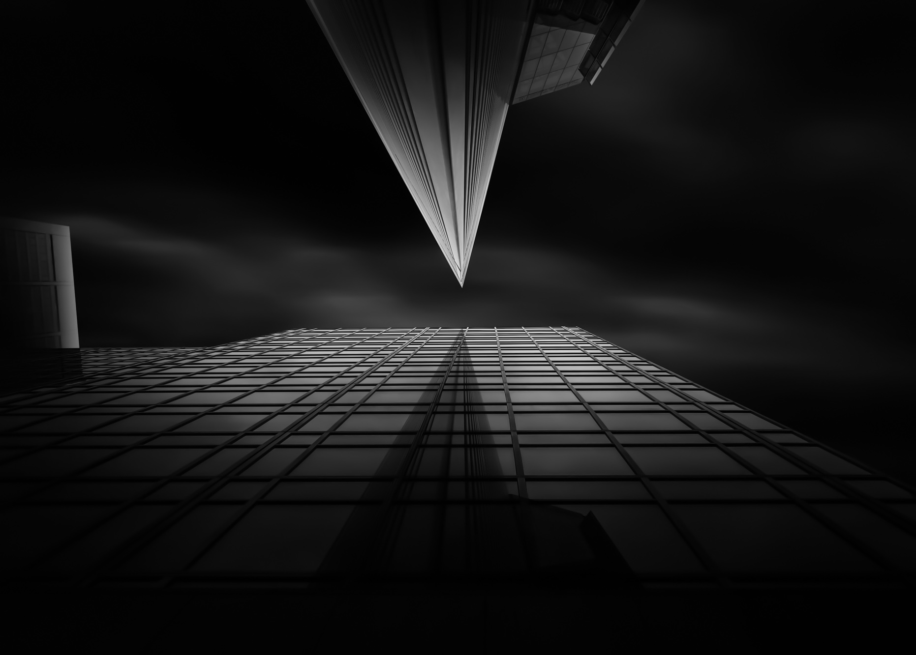 long exposure architecture photograph in dark tones of sharp pointed modern architectural buildings
