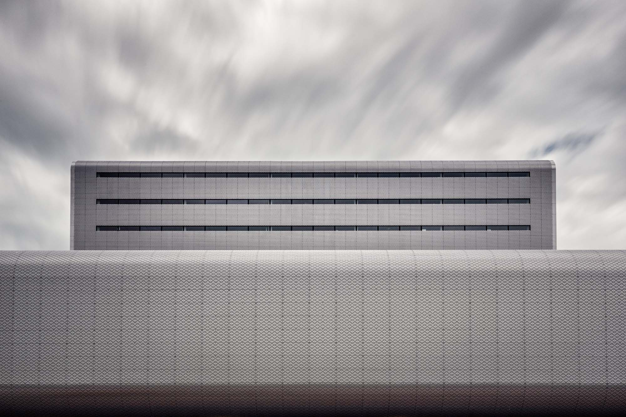 long exposure architecture photograph of stark minimalist metal building in Amsterdam