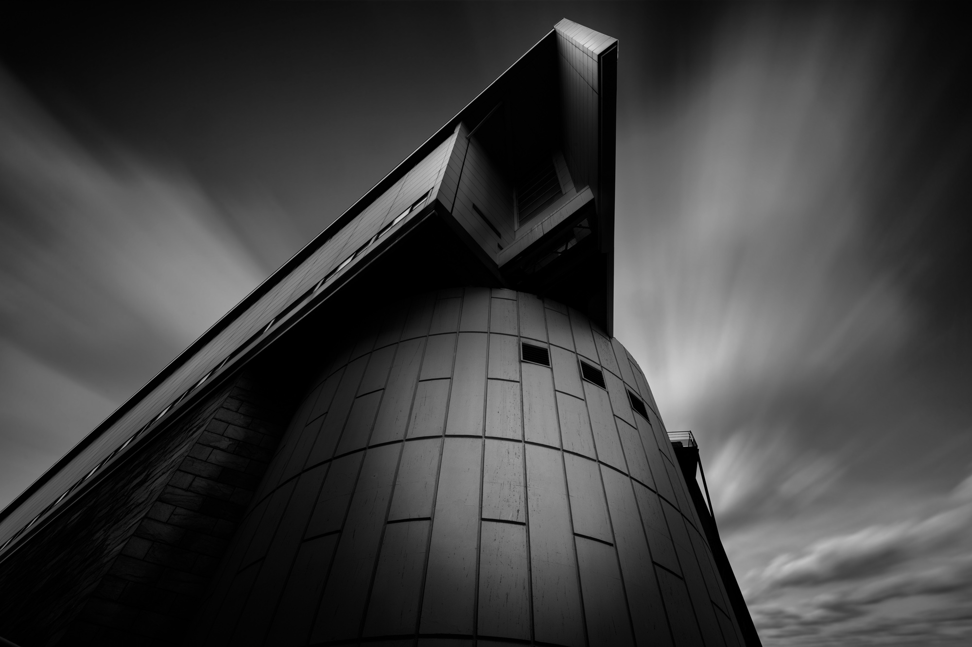 antonyz long exposure architecture photograph of a modern glass triangular office building