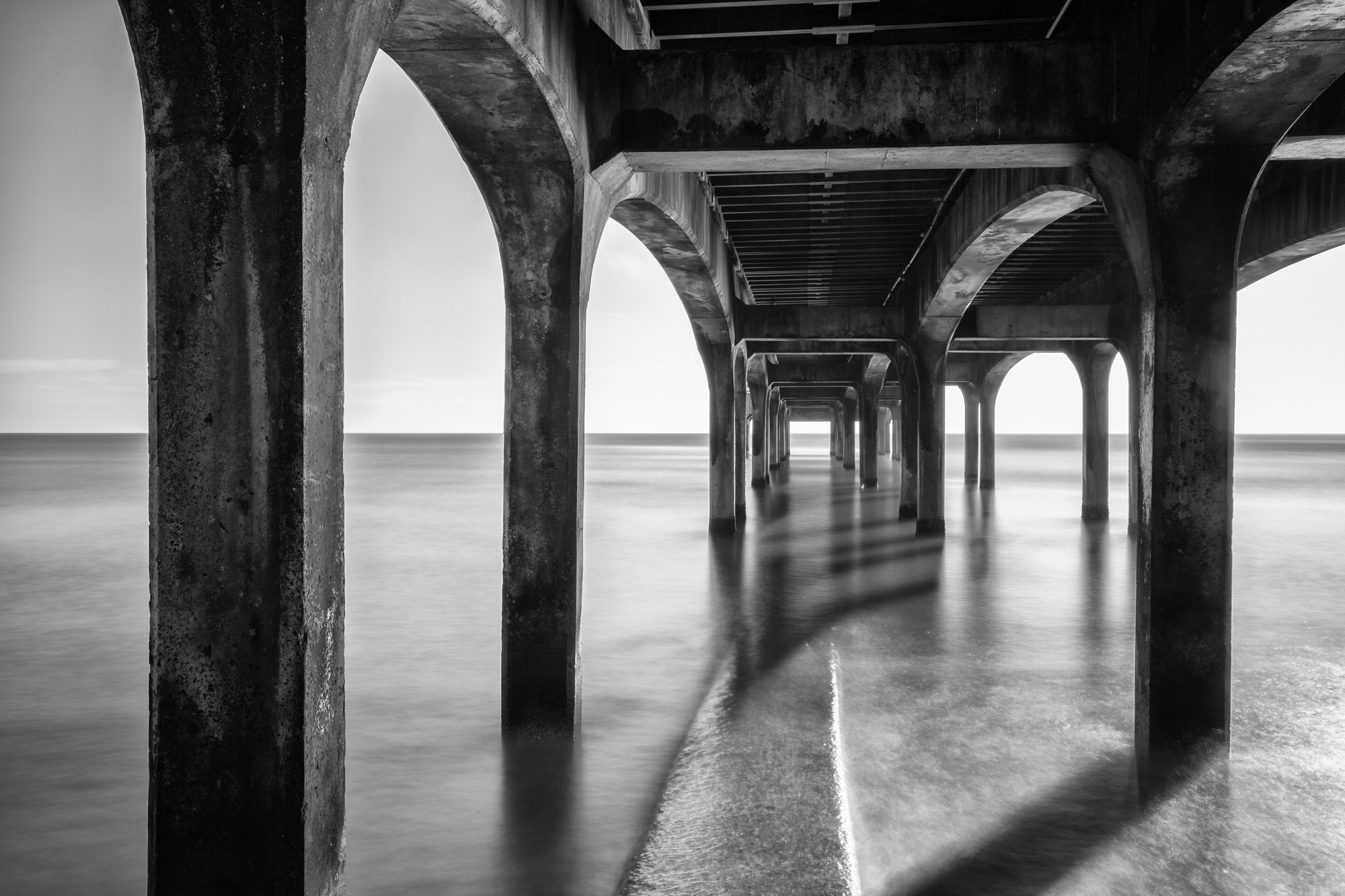 antonyz long exposure architecture photograph under wooden victorian jetty pier in the UK